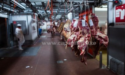 Beef hangs on hooks, December 17, 2012, at the international wholesale market in the southern Paris/AFP