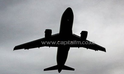 A silhouette picture of a plane flying/FILE