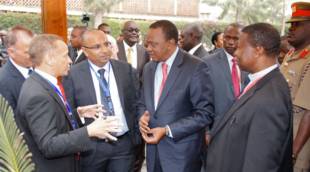 President Uhuru Kenyatta chats with the Regional General Manager, IBM East Africa, Nick Nesbitt during during the official launch of Research Lab Africa at Catholic University of Eastern Africa in Karen,Nairobi County/FILE