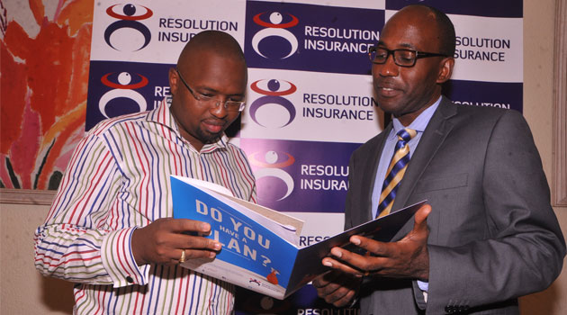 Resolution Insurance General Manager Commercial Services James Wanjohi with Dr Charles Kamotho, a cardiologist.
