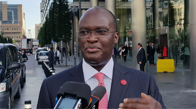 Transport CS James Macharia addresses Kenyan reporters in Brussels/PAUL CHIRCHIR