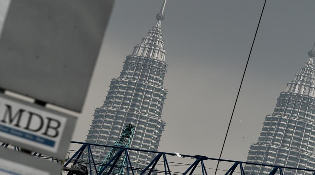 The 1 Malaysia Development Berhad logo is seen on a billboard at the funds flagship Tun Razak Exchange under-development site in Kuala Lumpur/AFP/GETTY