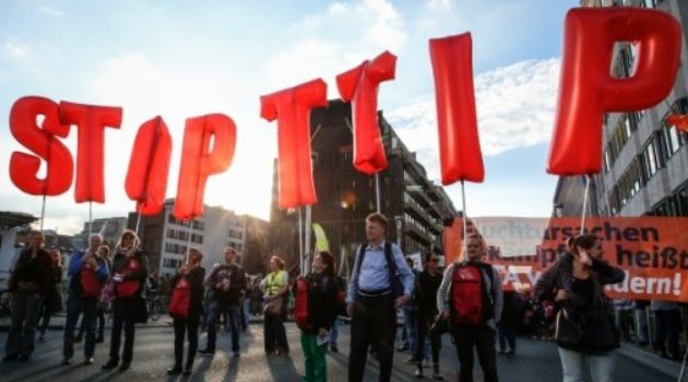 "People hold balloons reading ""Stop TTIP"" during a demonstration outside the European Union headquarters in Brussels/AFP-File"