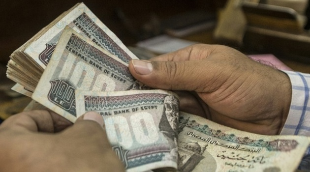 Last week, Egypt's central bank floated the Egyptian pound, which resulted in a steep devaluation and sharp price rises/AFP-File