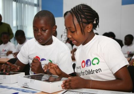 Lavington Primary School Pupils solving a mathematical sum on their Galaxy Note tablets.