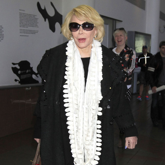 Joan Rivers arrives back in Los Angeles after a brief stint in Canada
