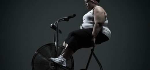 Overweight woman on exercise bike