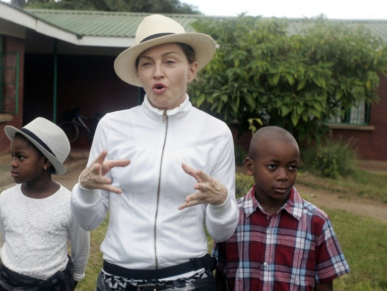 afp-madonna-takes-adopted-children-on-visit-home-to-malawi