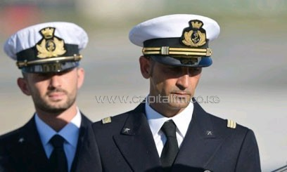 Italian marines Massimiliano Latorre (R) and Salvatore Girone (L) arrive at Ciampino airport on December 22, 2012/AFP