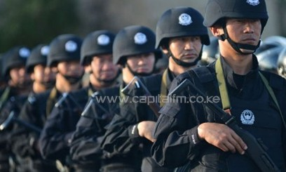 Anti-terrorism police take part in an exercise in Hami, northwest China's Xinjiang region on July 2, 2013/AFP