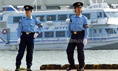 Japanese policemen patrol the Niigata Port, on June 8, 2003/AFP