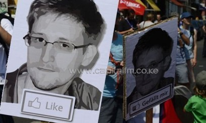 German activists hold posters of Edward Snowden as they protest in Berlin, on July 27, 2013/AFP