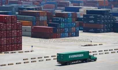 This picture taken on July 30, 2013 shows a truck transporting containers in Yangshan port in Shanghai/AFP