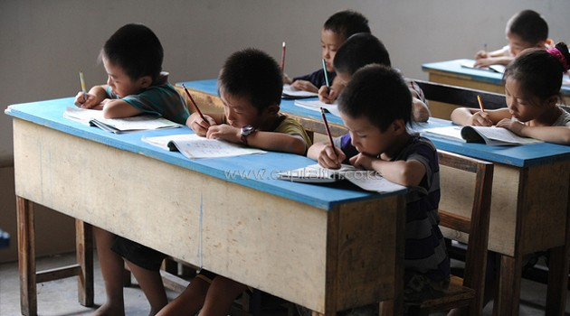 Children writing on their books/AFP