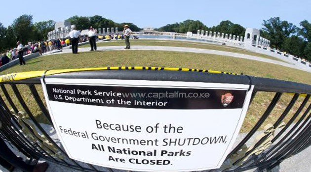 A closure sign is seen as US military war veterans visit the World War II Memorial on the National Mall in Washington, DC, on October 1, 2013/AFP