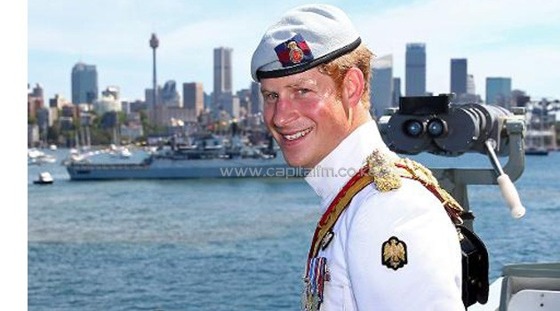 Prince Harry smiles from onboard the HMAS Leeuwin during the 2013 International Fleet Review, which commemorates the 100 year anniversary of the Royal Australian Navy's fleet arriving in Sydney, on October 5, 2013/AFP