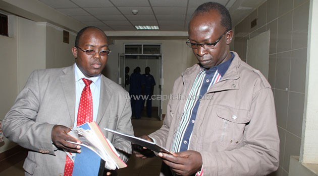 Walter Barasa confers with his lawyer Kibe Mungai at the Milimani Law Courts/MIKE KARIUKI