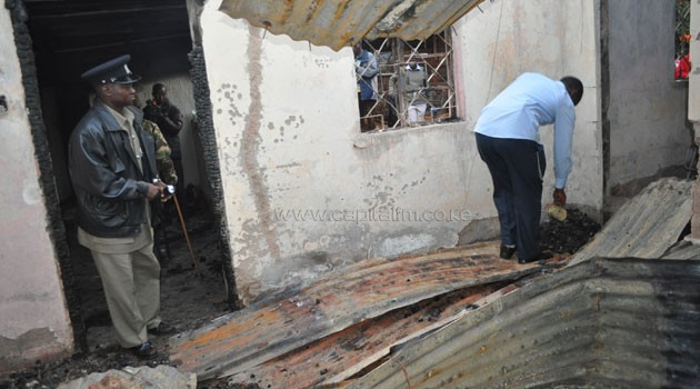 Police inspect the house where Owuor's parents met their death/CFM