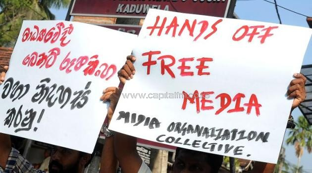 This file photo shows members of the Sri Lankan media participating in a silent protest outside a court in Kaduwela, a suburb of Colombo, on April 7, 2011/AFP