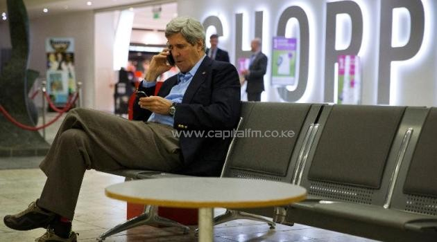 US Secretary of State John Kerry uses his phone during a refuelling stop at Shannon Airport in Ireland, on March 29, 2014, on his way to Paris/AFP