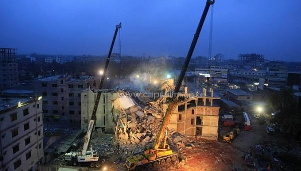 Cranes operated by Bangladeshi Army personnel are pictured at the scene following the April 24, 2013 collapse/AFP