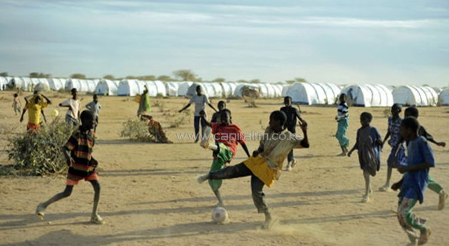 A group of children playing football/AFP