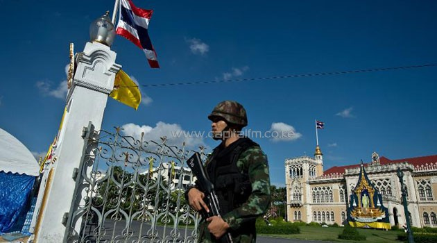 A Thai Army soldier stands guard at Government House, where the anti-government protesters had setup their main camp in Bangkok on May 23, 2014/AFP