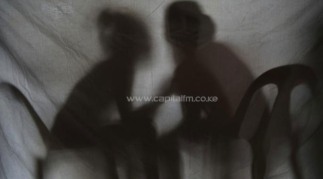 The shadow of two teenage girls rescued from a cyber sex den is seen in this photo taken at Preda Foundation office on December 2, 2010 in Olongapo City, Zambales province, north of Manila/AFP