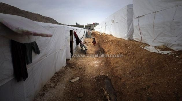 Rows of tents housing Syrian refugees at a camp in the city of Arsal in Lebanon's Bekaa valley on March 28, 2014/AFP