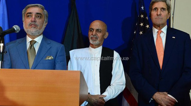 US Secretary of State John Kerry (right) watches as Afghan presidential candidates Ashraf Ghani (centre) and Abdullah Abdullah hold a joint press conference/AFP