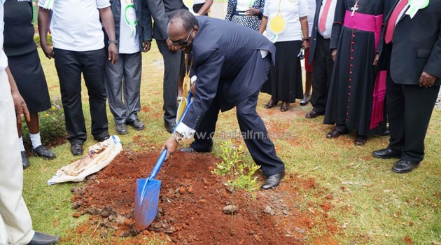 Dr Kirubi plants a tree at the institution/FRANCIS MBATHA