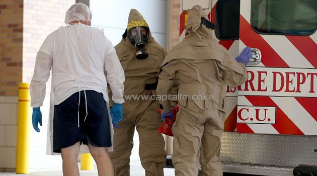 A suspected Ebola patient is brought to the Texas Health Presbyterian Hospital in Dallas, on October 8, 2014/AFP