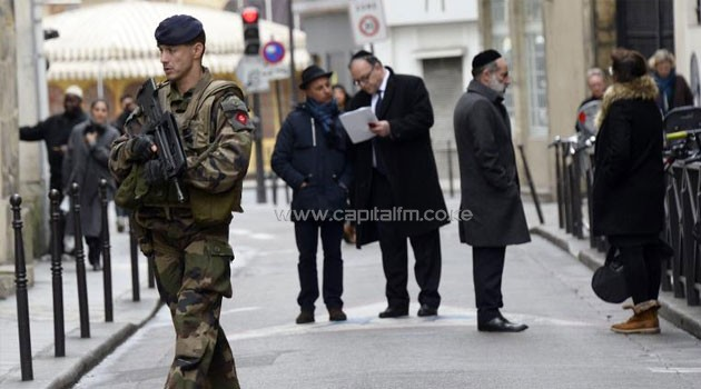 A French policeman patrols on January 12, 2015 in the Jewish quarter of the Marais district of Paris/AFP
