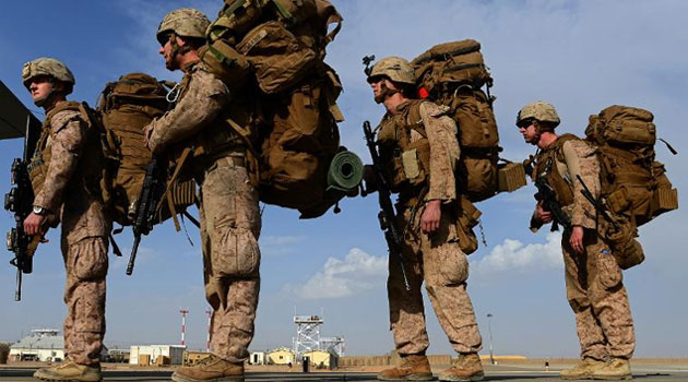 US Marines board a plane to Kandahar as British and US forces withdraw from the Camp Bastion-Leatherneck complex in Afghanistan's Helmand province in October 2014  © AFP