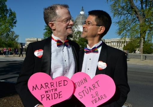 A married gay couple, John and Stuart, from California pose outside the US Supreme Court on April 28, 2015 in Washington, DC/AFP