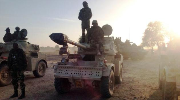 Soldiers of the Chadian army stand next to Panhard AML 90 armoured vehicles on January 21, 2015, at the border between Nigeria and Cameroon, some 40 km from Maltam, as part of a military contingent against the armed Islamist group Boko Haram/AFP