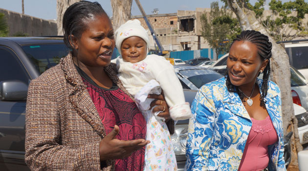 Baby Bhakita, her mother and Capital FM News Judie Kaberia at the JKIA. Photo/ FRANCIS MBATHA