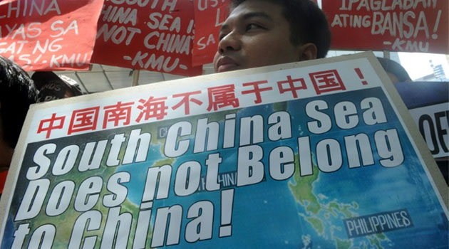 Protesters rally outside the Chinese Consulate in Manila on July 7, 2015, denouncing China's claim to most of the South China Sea including areas claimed by the Philippines © AFP
