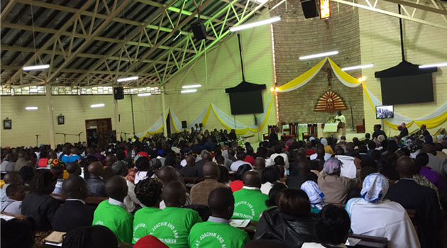 Hundreds of selected slum residents arrived at the Church early for the Pope's meeting.