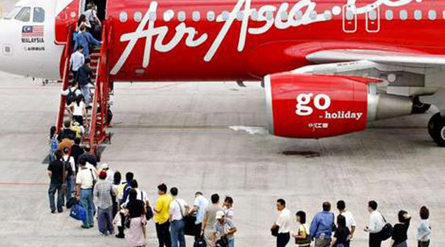 Passengers boarding Air Asia plane/FILE