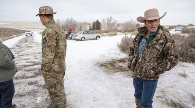 Members of a group of armed anti-government protesters are seen at the Malheur National Wildlife Refuge near Burns, Oregon on January 4, 2016/AFP