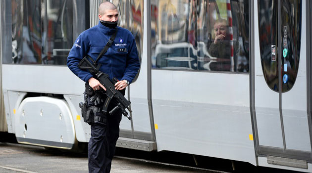 In dramatic scenes, one of the suspects was shot in the leg at a tram stop in broad daylight in a huge operation by police in the Belgian capital's Schaerbeek district/AFP
