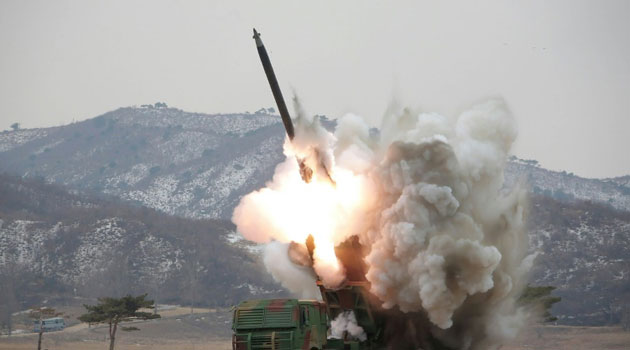 Undated photo released on March 4, 2016 shows a test-fire of a new large-caliber rocket at an undisclosed location in North Korea/AFP FILE
