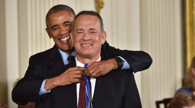 US President Barack Obama presents actor Tom Hanks with the Presidential Medal of Freedom in the East Room of the White House in Washington, DC on Nov 22, 2016/AFP