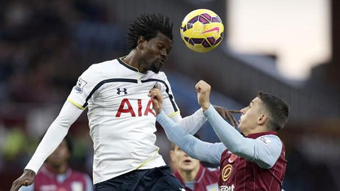 Emmanuel Adebayor (left) playing for Tottenham against Aston Villa in the English Premier League. PHOTO/File