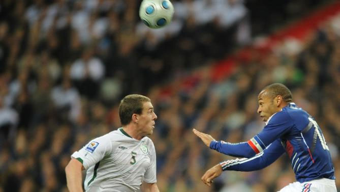 French forward Thierry Henry (R) fights for the ball with Irish defender Richard Dunne during a World Cup 2010 qualifying football match on November 18, 2009 at the Stade de France in Saint-Denis, northern Paris