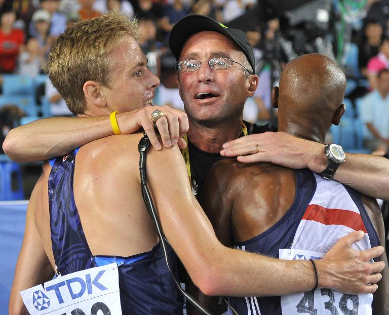 US athletics coach Alberto Salazar (centre) hugs Galen Rupp (left) and Mo Farah after the men's 5,000 metre final at the 2011 world championships in Daegu, South Korea