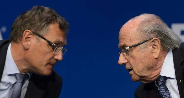 FIFA president Sepp Blatter (R) speaks with FIFA Secretary General Jerome Valcke during a press conference on May 30, 2015 in Zurich after being re-elected during the FIFA Congress