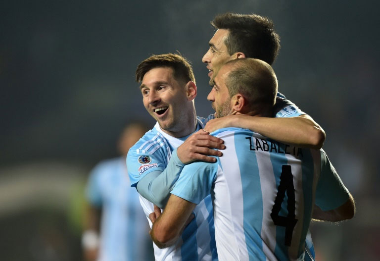 Argentina's Javier Pastore (C) celebrates with teammates Lionel Messi (L) and Pablo Zabaleta after scoring against Paraguay during their Copa America semi-final match in Concepcion, Chile. PHOTO/AFP