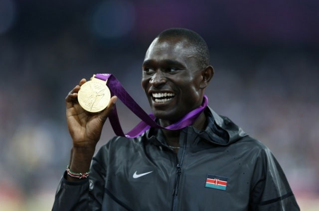 Kenya captain to London 2012 Olympics, David Rudisha, poses with his men 800m gold medal he won in a world record. NOC-K launched the fundraising drive to Rio on Thursday. PHOTO/FILE